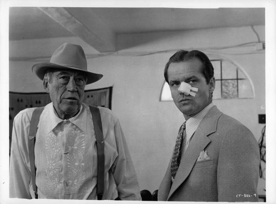 John Huston speaking to Jack Nicholson in a scene from the film 'Chinatown', 1974.