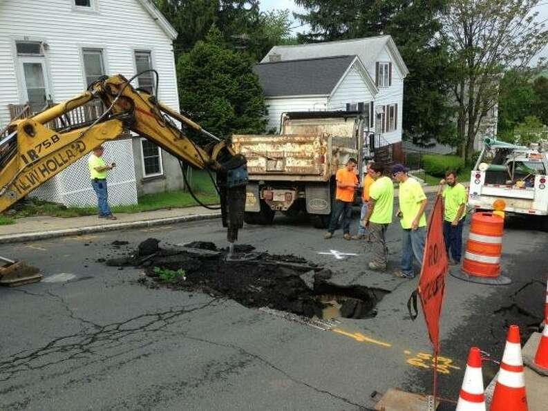 Authorities in Troy have closed Lincoln Avenue after a sink hole opened up on Tuesday, May 22, 2013.