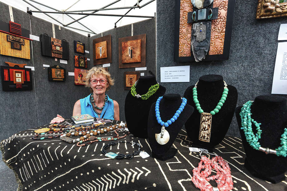 Pam Ameduri displays various pieces of her artwork in her booth at Boerne's Main Plaza on Saturday, May 18, 2013 during Best of BoerneFest 2013.  Photo by Marvin Pfeiffer / Prime Time Newspapers Photo: MARVIN PFEIFFER, Marvin Pfeiffer / Prime Time New / Prime Time Newspapers 2013