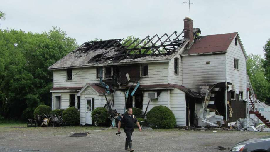 An overnight fire consumed a former restaurant and home at 55 West Sand Lake Road, Wynantskill. (Bob Gardinier/Times Union)