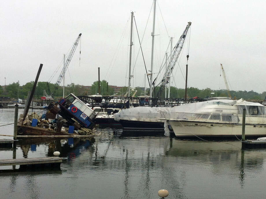 A crane on a barge in Stamford Harbor toppled over and landed on a 47-foot powerboat on Wednesday, May 22, 2013. Photo: Lindsay Perry