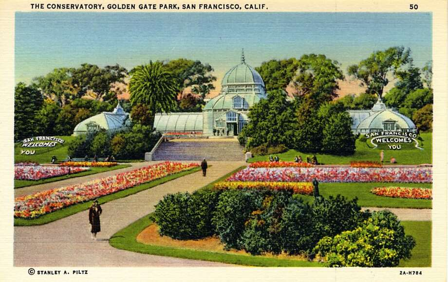 Vintage linen postcard showing the exterior of the conservatory and the landscaped grounds surrounding it. Flower beds spell out 'San Francisco Welcomes You.'  Photo: Curt Teich Postcard Archives