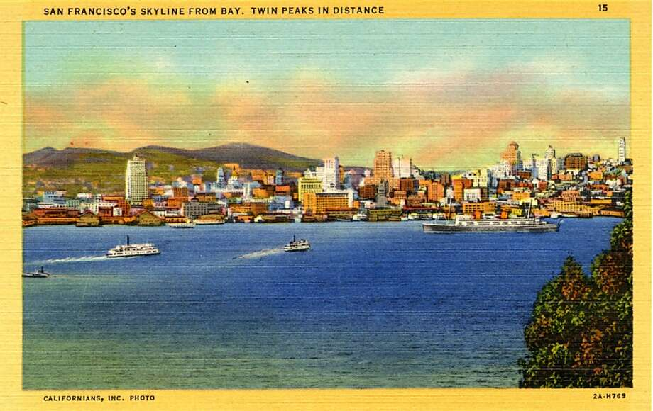 Vintage linen postcard showing San Francisco's skyline from across the Bay, with Twin Peaks visible in the distance.  Photo: Curt Teich Postcard Archives