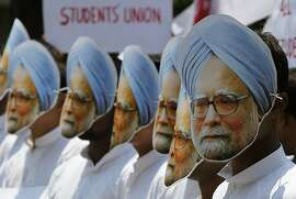 Student activists wear masks of Indian Prime Minister Manmohan Singh during a protest against Singh, claiming he has not done anything for the state of Assam, where he was nominated from, in Gauhati, India, Wednesday, May 15, 2013. Singh on Wednesday filed his nomination papers for his fifth Upper House term in parliament from the Indian eastern state of Assam. (AP Photo/Anupam Nath)