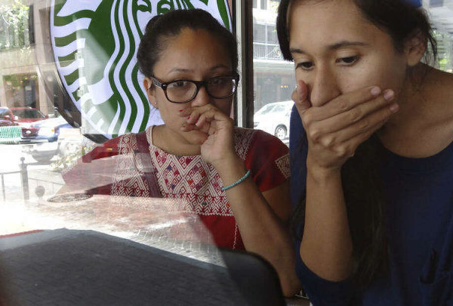Pamela Resendiz (left) and Carolina Canizales last year watch an internet broadcast of President Barack Obama announcing a new policy to halt some deportations. Both girls are hoping to obtain legal status through the new rules. Photo: San Antonio Express-News