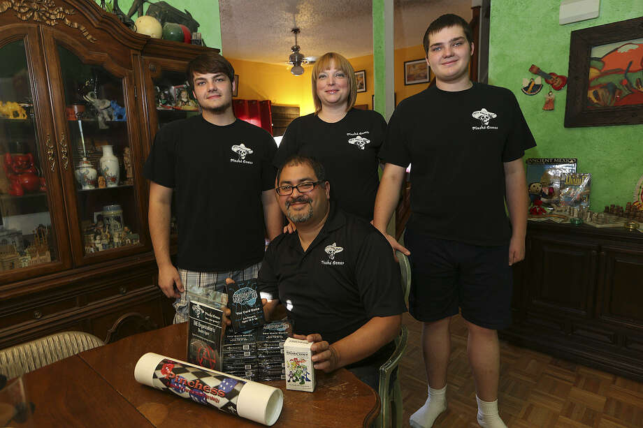 Pinché Games founder Vince Guzman and his family, Zachary Phillips, 15 (from left), Colleen Guzman, and Nicolas Phillips, 15. Photo: Jerry Lara / San Antonio Express-News