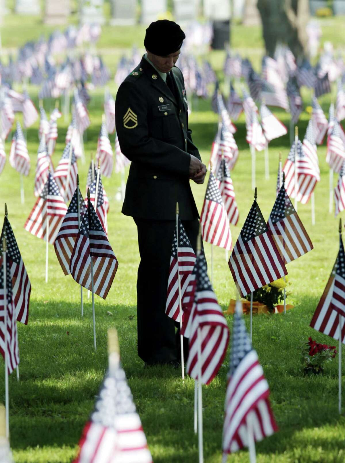 A soldier walks in a national cemetery on Memorial Day in 2010. Memorial Day honors those who have died while serving in this country's armed forces.