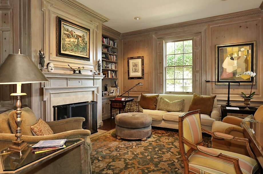 The wood-paneled library includes a fireplace and hidden wet bar. Photo: Liz Rusby/The Grubb Co.