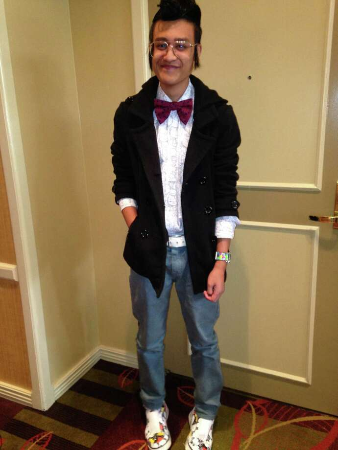 Joshua Tadeo, 21, says he's an eccentric and a child at heart when it comes to his style. The Palo Alto college student certainly likes patterns and color as evidenced by his Hello Kitty print shirt and a red textured bowtie. He tops the look with a lightweight pea coat with pushed-up sleeves. Another eccentric influence are his causal sneakers with an artisitc print by Andy Warhol, one of his idols. His swirled pompadour and long sideburns are influenced by the 1950s, a favorite era. - Michael Quintanilla