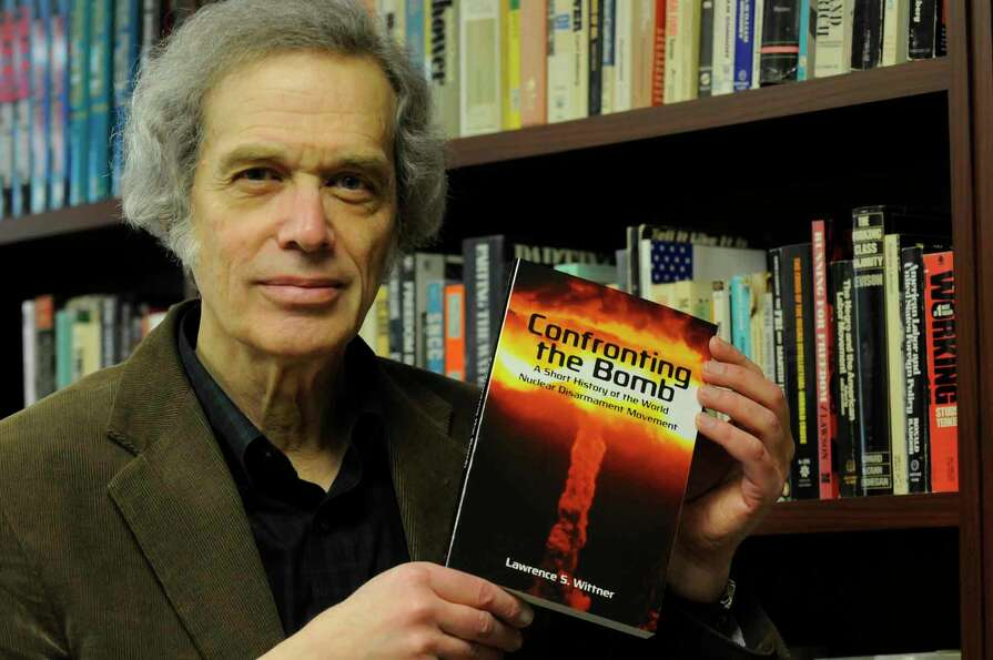Author and University at Albany history professor Lawrence Wittner holds his new book