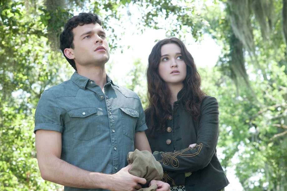 John Bramley/Warner Bros. Pictures (L -r) ALDEN EHRENREICH as Ethan Wate and ALICE ENGLERT as Lena Duchannes in Alcon Entertainment's supernatural love story ?BEAUTIFUL CREATURES,? a Warner Bros. Pictures release. Photo: John Bramley / © 2013 Alcon Entertainment, LLC
