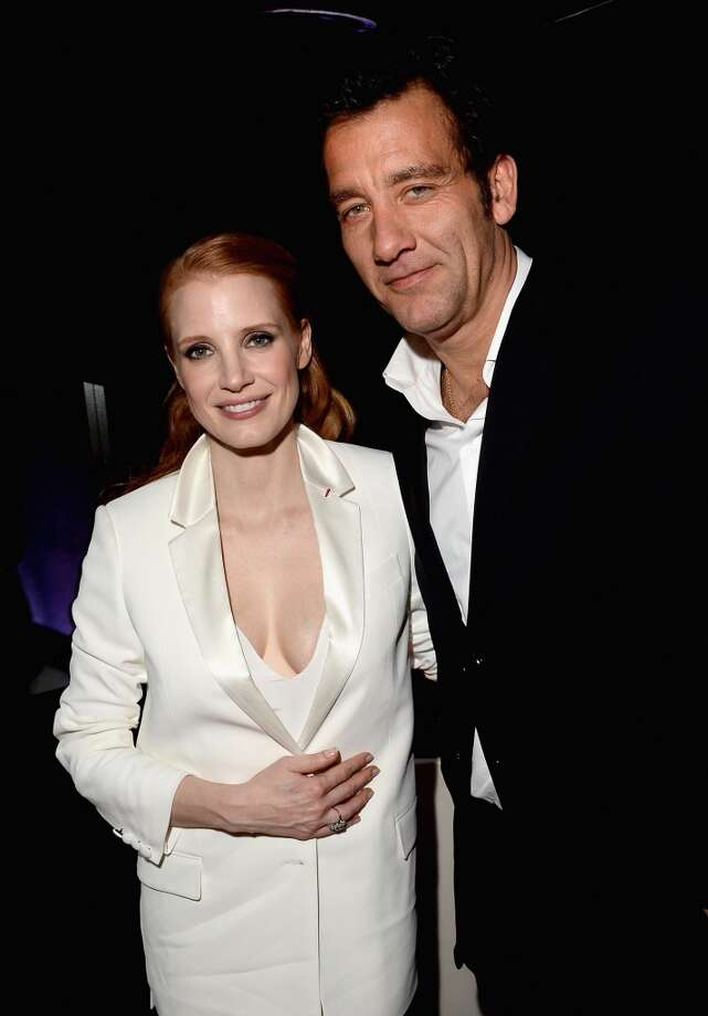 CANNES, FRANCE - MAY 21:  Actors Jessica Chastain and Clive Owen attend the 'Cleopatra' cocktail hosted by Bulgari during The 66th Annual Cannes Film Festival at JW Marriott on May 21, 2013 in Cannes, France.  (Photo by Venturelli/Getty Images for Bulgari)