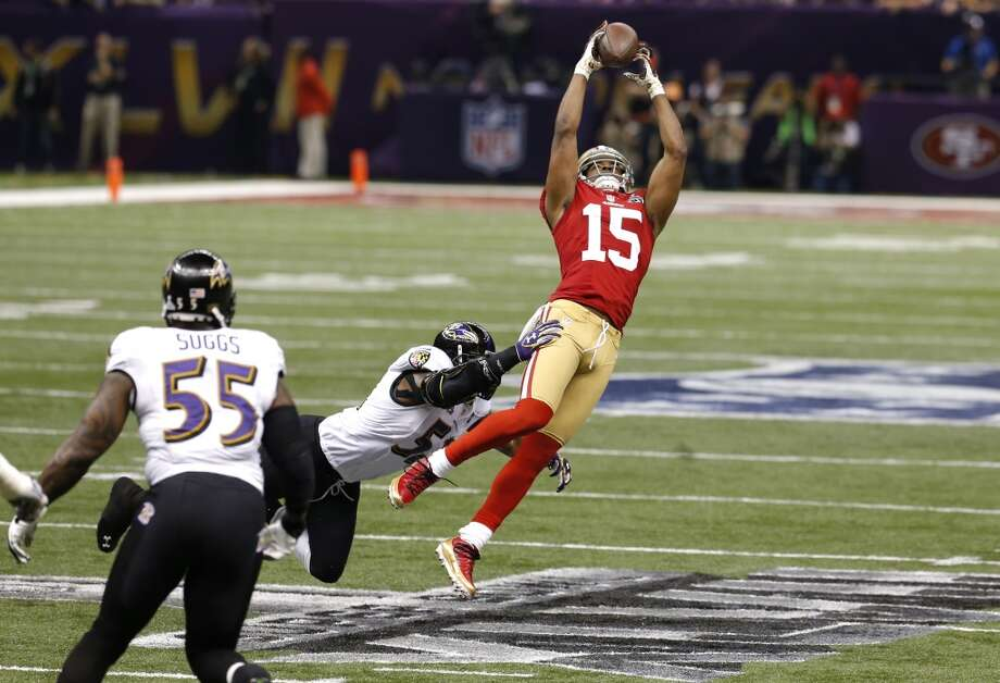 Wide receiver Michael Crabtree catches a pass downfield in the first quarter of Super Bowl XLVII.