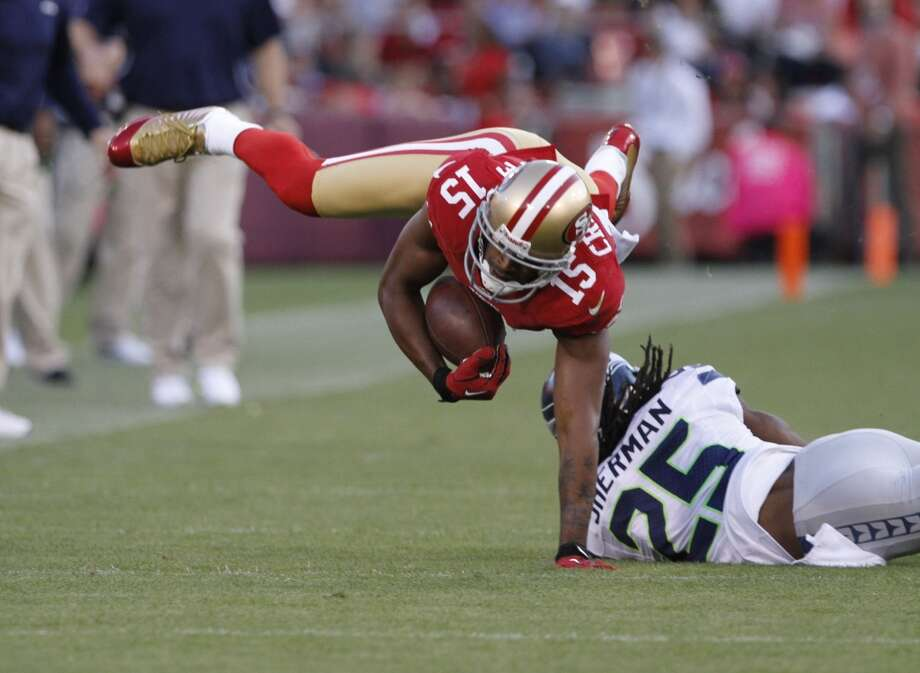 Wide receiver Michael Crabtree (15) catches a pass and continues down filed leading to a 49ers field goal during the first quarter of the San Francisco 49ers game against the Seattle Seahawks at Candlestick Park in San Francisco, Calif., on Thursday October 18, 2012.