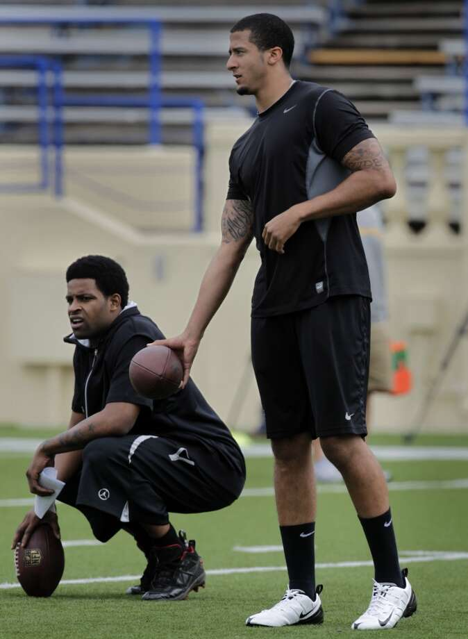 Wide receiver Michael Crabtree, left, attends a 49ers players' practice with rookie quarterback Colin Kaepernick at Spartan Stadium in 2011.