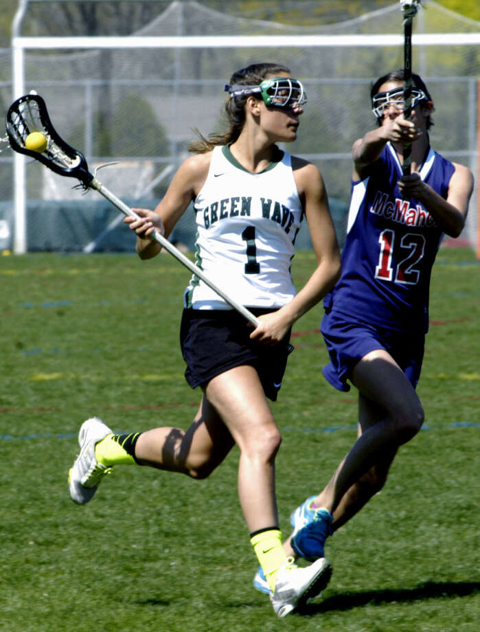 The Green Wave's Destinee Carey surveys the offensive zone for an open teammate during New Milford High School girls' lacrosse's 17-9 victory over Brien McMahon, April 27, 2013 at NMHS. Photo: Norm Cummings
