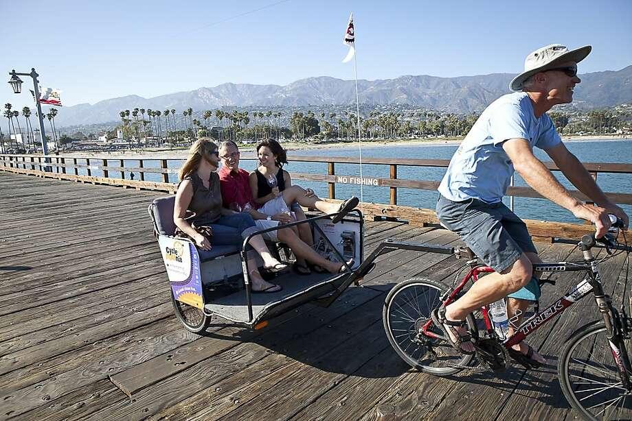 A pedicab is a great way to wheel around town, including at Stearns Wharf in Santa Barbara. Photo: Matt Dayka, Santa Barbara CVB & Film Comm.