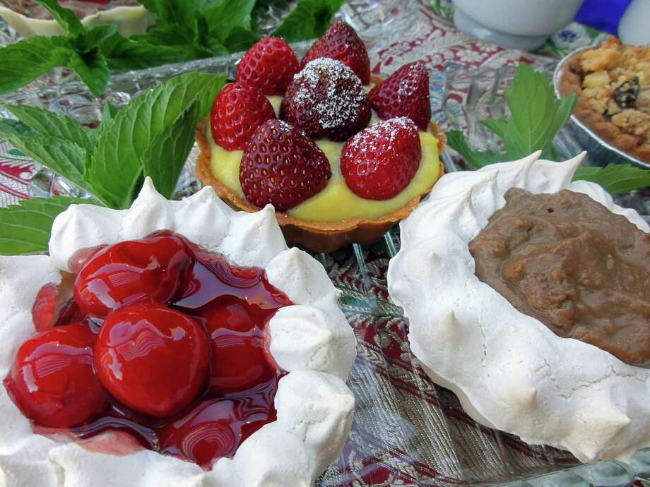 Meringue tarts are light and delicate. Fill them with canned pie filling, chocolate pastry cream or fresh fruit. (Sharon K. Ghag/Modesto Bee/MCT) Photo: Sharon K. Ghag / Modesto Bee