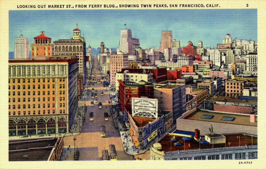 Vintage linen postcard showing a bird's eye view of the Market and the surrounding area. Trolly cars travel on the streets and the Twin Peaks can be seen faintly in the distance. Photo: Getty Images / Curt Teich Postcard Archives