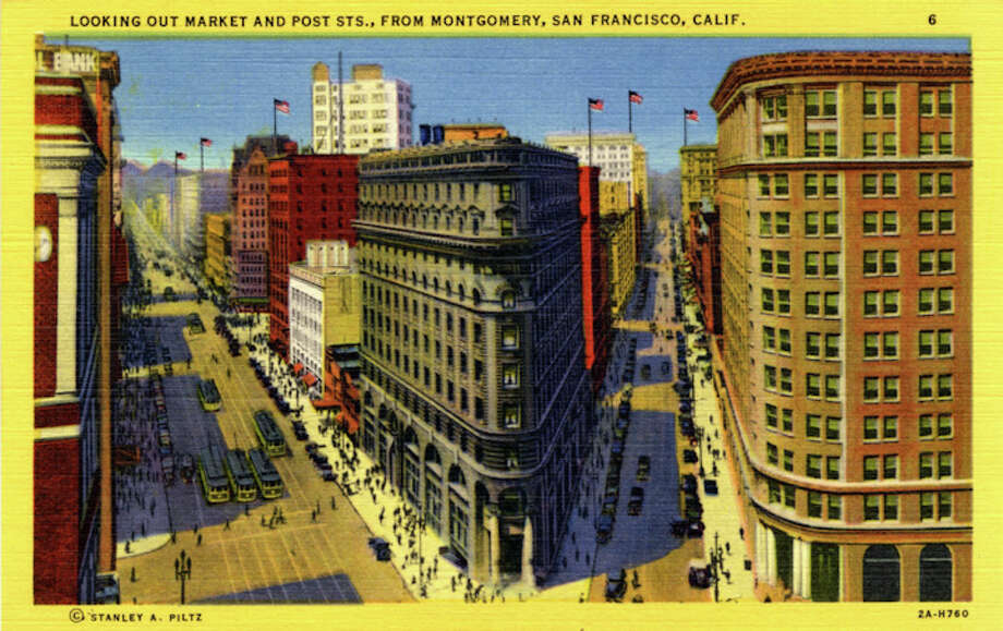 Vintage linen postcard showing Market Street and the Flatiron Building.  The streets are teeming with traffic, trolleys and pedestrians. Photo: Getty Images / Curt Teich Postcard Archives