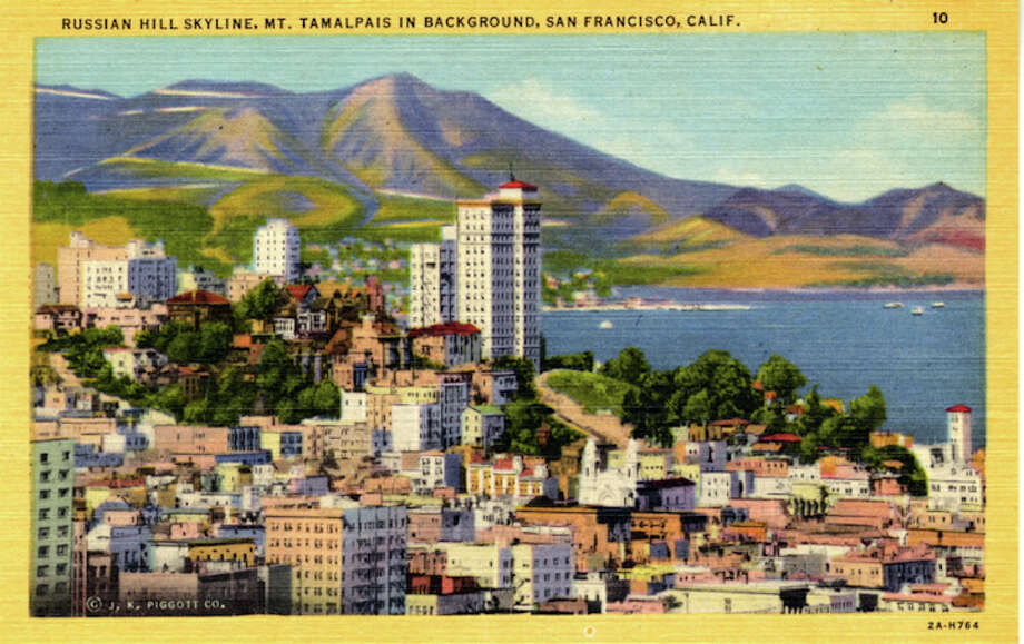 Vintage linen postcard showing a bird's eye view of the Russian Hill skyline.  The Bay and Mt. Tamalpais are visible in the distance. Photo: Getty Images / Curt Teich Postcard Archives
