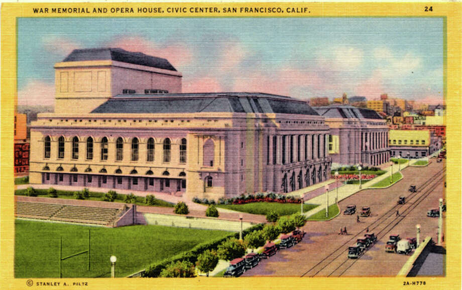 Vintage linen postcard showing the exterior of the War Memorial and Opera House and the athletic fields for the High School of Commerce. Photo: Getty Images / Curt Teich Postcard Archives