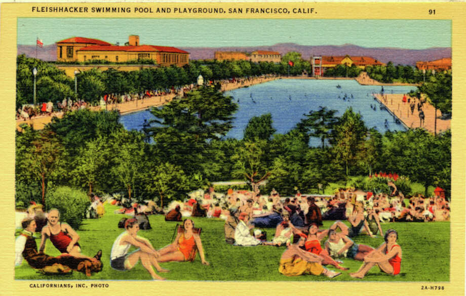 Vintage linen postcard showing the world's largest outdoor, heated swimming pool and the surrounding grounds.  Dozens of bathers sit on the grass in the foreground. Photo: Getty Images / Curt Teich Postcard Archives
