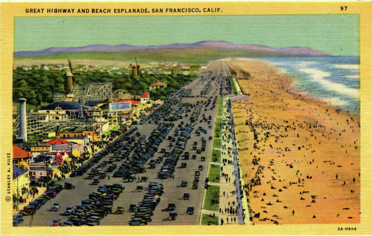 Vintage linen postcard shows a bird's eye view of the Great Highway and Beach Esplanade looking south. Cars fill the parking areas and hundreds of bathers are on the beach. Playland amusement park is visible on the left.