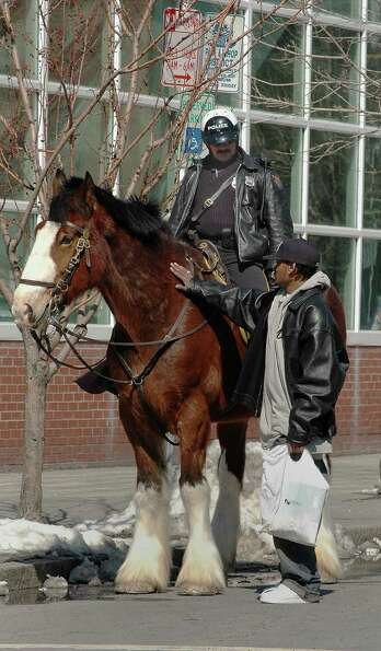 In this March 2005 file photo, Troy Police Officer Sam Carrello and his mount Big Ben, a Shire horse
