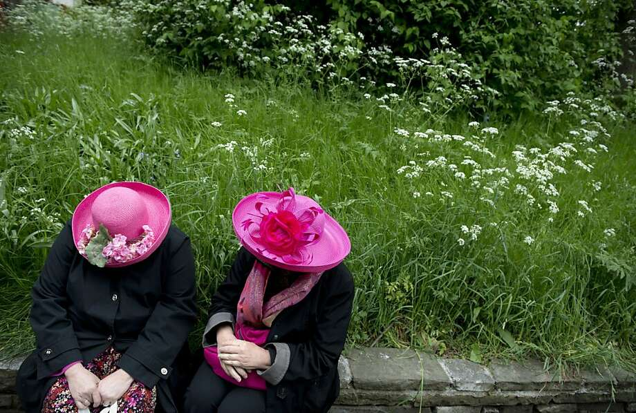 I can't believe you wore your flowered pink hat when you knew I was going to wear my flowered pink hat:Two women discuss floral matters at 