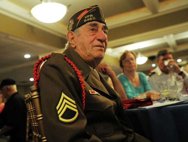 World War 2 veteran Nick Angelicola, of Stratford, wears his original dress uniform to the Town of Stratford's 2013 Veterans Breakfast at Vazzano's Four Seasons banquet facility in Stratford, Conn. on Wednesday, May 22, 2013. Photo: Brian A. Pounds / Connecticut Post