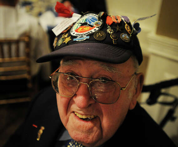 World War 2 and Battle of the Bulge veteran Joseph Minto, of Bridgeport, wears a hat covered with his medals at the Town of Stratford's 2013 Veterans Breakfast at Vazzano's Four Seasons banquet facility in Stratford, Conn. on Wednesday, May 22, 2013. Photo: Brian A. Pounds / Connecticut Post
