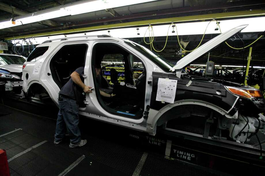 FILE - In this Dec. 1, 2010 file photo, plant employees assemble a 2011 Ford Explorer on the assembly line at Ford's Chicago Assembly Plant. Ford Motor Co. said Wednesday, May 22, 2013 that 21 of its North American factories will shut for only one week this summer. That includes the Chicago plant that makes the Ford Explorer SUV and the Mexican plant that makes the Fusion sedan.  (AP Photo/M. Spencer Green, File) Photo: M. Spencer Green