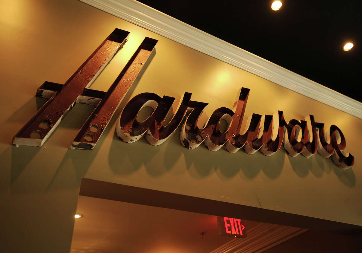 A section of the iconic Harrison's Hardware sign decorates the wall of The Colony Grill at 36 Broad Street on the Green in downtown Milford, Conn. on Wednesday, May 22, 2013.