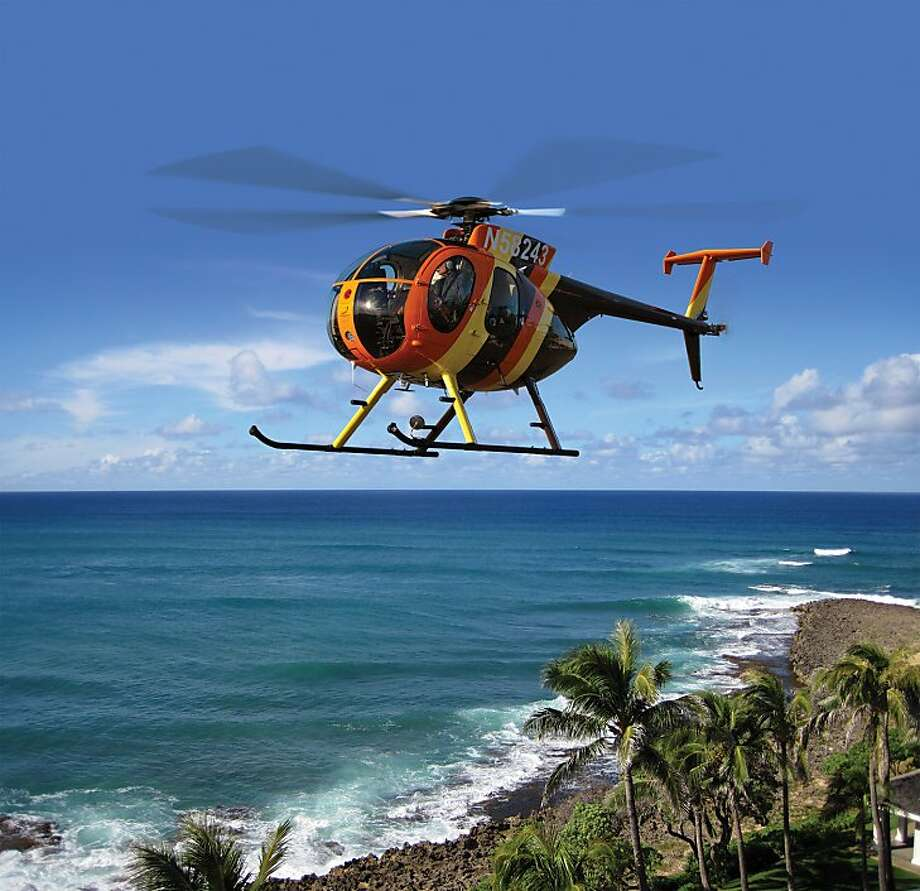 """Sightseeing: Get on your parrot-motif aloha shirt and climb aboard the fully reconditioned helicopter from """"Magnum, P.I.,"""" which will offer aerial tours of the North Shore, Windward Side and Waikiki from Paradise Helicopters' home base at Turtle Bay, after a """"welcome home luau"""" June 3 with series stars Larry Manetti (""""Rick"""") and Roger E. Mosley (""""T.C."""") A portion of process from flights on the Chopper will benefit the Wounded Warrior Project, which aids injured military personnel. Photo: Paradise Helicopters"""