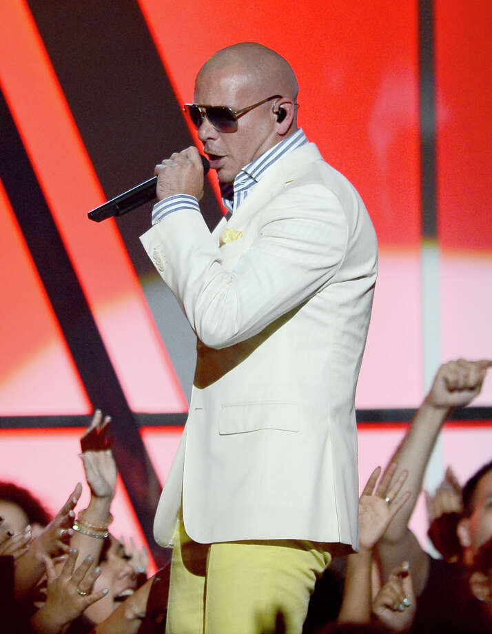 Pitbull comes to town June 22 with Ke$ha. Photo: Ethan Miller, Staff / 2013 Getty Images