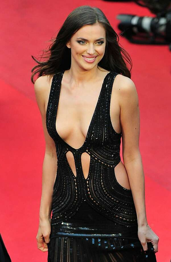 "Chic Shayk:Supermodel Irina Shayk, known for appearing in Sports Illustrated in swimsuits, wears a slightly more substantial outfit for the ""All Is Lost"" premiere at Cannes. Photo: Gareth Cattermole, Getty Images"
