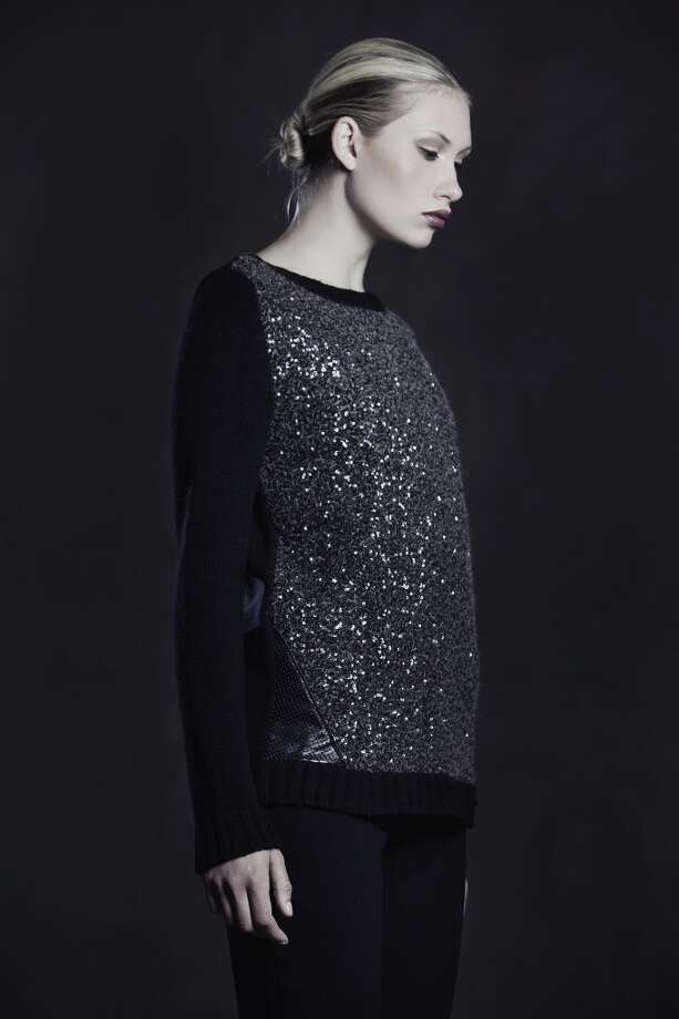 Sequin felted knit and perforated leather pullover.