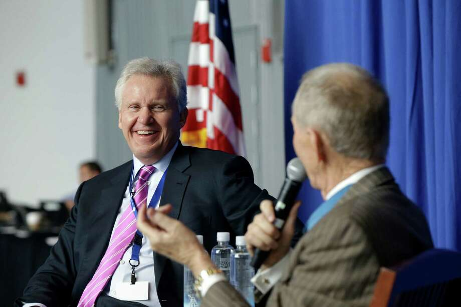 Jeff Immelt, Chairman and CEO of General Electric, left. The company is considering spinning off parts of its finance unit through an initial public offering as Immelt works to shrink the business. Photo: Gerald Herbert, Associated Press / AP