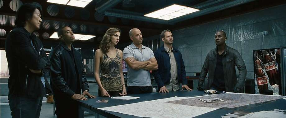 "Han (Sung Kang), from left, Tej (Chris ""Ludacris"" Bridges), Gisele (Gal Gadot), Dom (Vin Diesel), Brian (Paul Walker) and Roman (Tyrese Gibson) reunite for ""Fast & Furious 6."" (Universal Pictures/MCT) Photo: Handout, McClatchy-Tribune News Service"