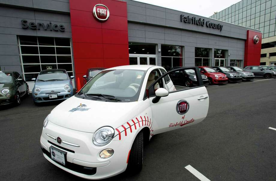 A Fiat 500 POP at Callari Fiat in Stamford, Conn., decorated in a baseball design for display at a Bluefish game and the Cooperstown Classic golf tournament. Photo: Lindsay Perry / Stamford Advocate