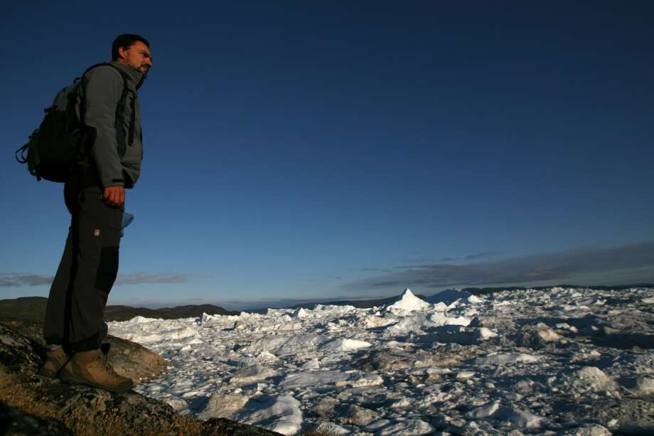A tourist watches the Jacobshavn Fjord, on August 29, 2007 near the town of Ilulissat in Greenland.