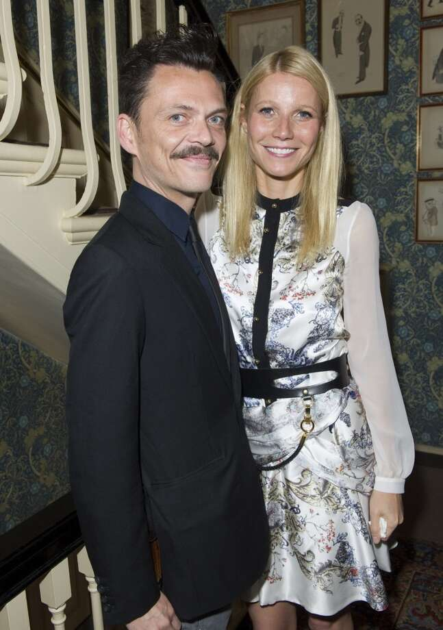 LONDON - MAY 21:  Matthew Williamson and Gwyneth Paltrow  pose at Goop's party to launch the summer season,  at Mark's Club on May 21, 2013 in London, England.  (Photo by David M. Benett/Getty Images)