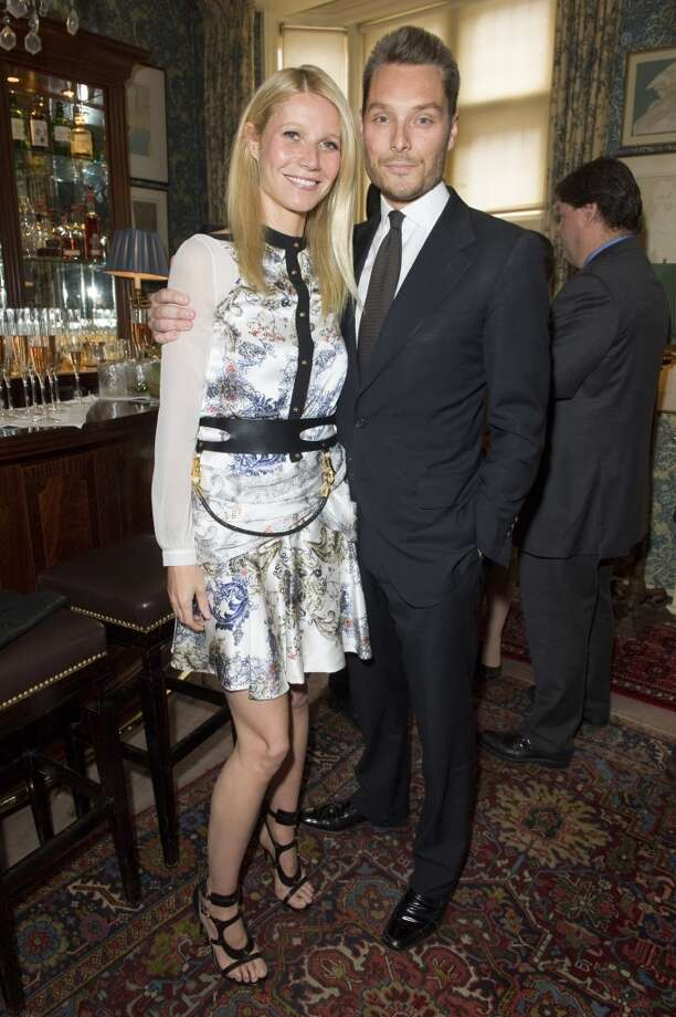 LONDON - MAY 21:  Gwyneth Paltrow and Seb Bishop pose at Goop's party to launch the summer season,  at Mark's Club on May 21, 2013 in London, England.  (Photo by David M. Benett/Getty Images)