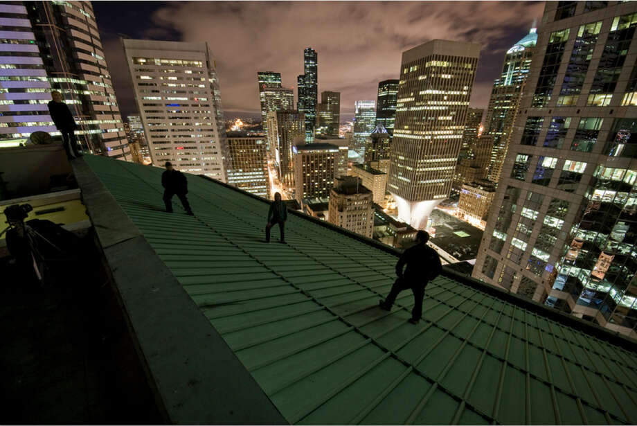 Climbers on a downtown Seattle building are shown in this image uploaded to the Internet.