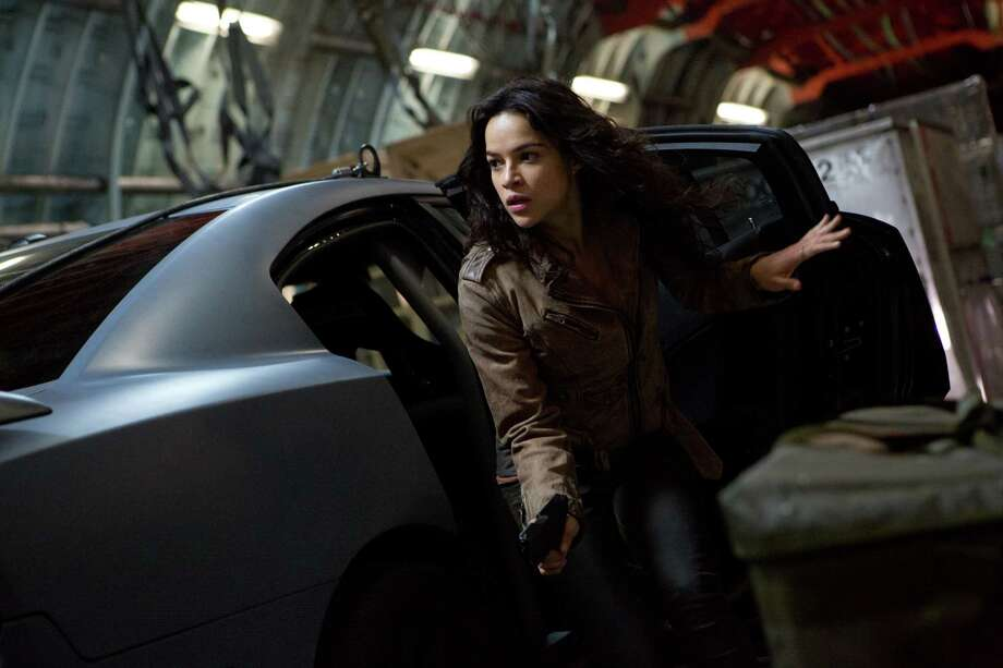 "This film publicity image released by Universal Pictures shows Michelle Rodriguez in a scene from ""Fast & Furious 6."" (AP Photo/Universal Pictures, Giles Keyte) Photo: Giles Keyte, HOEP / Universal Pictures"