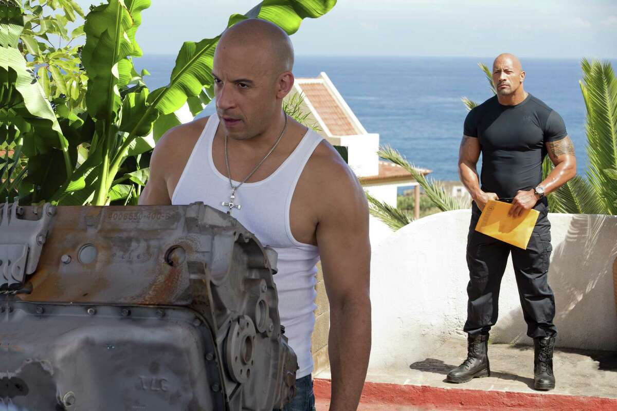 """Vin Diesel (left) and Dwayne Johnson co-star in """"Fast & Furious 6,"""" a summer action movie that requires minimal thought."""