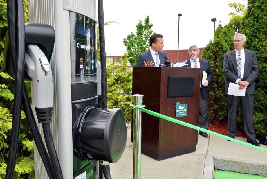 CEO of ChargePoint, Pat Romano, center, NYSERDA's Frank Murray and National Grid regional exec Bill Flaherty, at right, unveil a new EV charging station at Homewood Suites in Colonie, NY, Wednesday May 22, 2013.  (John Carl D'Annibale / Times Union) Photo: John Carl D'Annibale / 00022500A