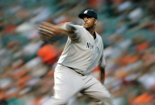 In this photo made with a slow shutter speed, New York Yankees starting pitcher CC Sabathia throws to the Baltimore Orioles in the fourth inning of a baseball game in Baltimore, Monday, May 20, 2013. (AP Photo/Patrick Semansky) Photo: Patrick Semansky, Associated Press / AP