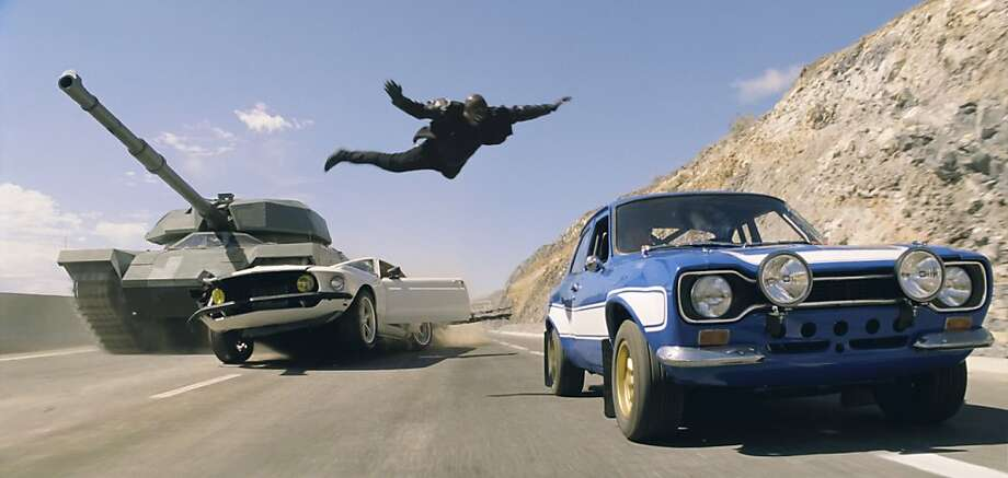 "Roman (Tyrese Gibson) makes a death-defying leap in ""Fast & Furious 6,"" one of many action sequences in the film, which includes lots of car chases and street races. Photo: Universal Pictures"